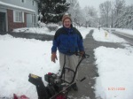 This man was having fun with his snow blower, and wanted his picture taken!